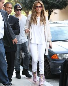 Keep up, Casper! Smart followed behind J-Lo as they made their way out of a local radio station in LA