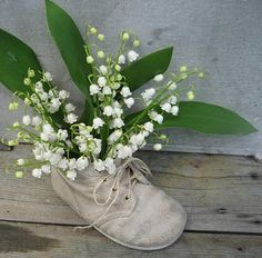 lily of the valley and baby shoe