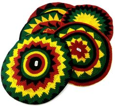 Crocheted Cotton Rasta Tam Hat (assorted styles) Sport your own style in this fashionable tam hat! Crocheted from 100% cotton yarn in the Rastafarian flag colors of red, yellow and green with black. Each hat is uniquely styled and the light fabric is suitable for year-round wear.