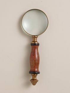 Add character to your home office with a brass and wood magnifying glass. Mini Wood and Brass Magnifying Glass, $6. worldmarket.com.