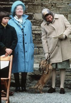 Queen Elizabeth II and her pet dorgi -- a cross between a dachshund and a corgi. Badminton, England, 1976. With her are the Queen Mother and (left) Lady Sarah Armstrong Jones.