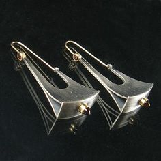 i love the industrial yet soft look of these earrings by artist Jude Clarke. www.facerejewelryart.com/artist.php?id=6