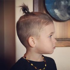 This is the look Silas is going for. He wants a little man bun so badly.