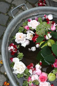 Party/ shower inspiration: a huge tub filled with floating flowers and candles. So pretty.