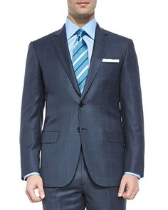 Brioni two-piece windowpane suit. Notch lapel; two-button front. Unfinished sleeves. Front flap pockets; chest welt pocket. Double-vented back. Single pleat trousers; unfinished hem to be tailored to
