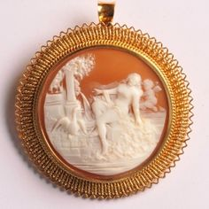 Shell cameo brooch o fLeda and the swan, with a putti in the background.  Very fine carving.  The brooch can also be worn as a pendant by using the hinged loop  45mm diameter, www.osprey.fr  €1240 Paris, Swan, Shells, Vintage Jewelry, Carving, Jewels, Pendant, Conch Shells, Montmartre Paris