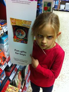 """This Little Girl Just Schooled Tesco Over A Sexist Sign Because """"Anybody Can Like Superheroes"""""""