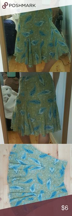 """Fun paisley skirt This olive and blue colored paisley skirt has an elastic waist band and is fully lined. Fitted at waist and flares out towards the bottom hem from just above the knee. Polyester material doesn't fade! Pretty and fun, this skirt has been loved but needs a new home. Model is 5'1""""; 140lbs. No stains, pet-free & smoke-free home. Skirts A-Line or Full"""