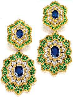 Earrings: SAPPHIRE, EMERALD AND DIAMOND NECKLACE AND PAIR OF MATCHING PENDENT EAR CLIPS, Gianmaria Buccellati. The necklace composed of 14 floral links each centring on an oval sapphire together weighing 20.90 carats, to openwork petals set with brilliant-cut diamonds and circular-cut emeralds together weighing approximately 5.40 and 19.10 carats respectively; and pair of matching pendent ear clips, sapphires and emeralds altogether weighing approximately 7.90 and 4.50 carats respectively.