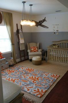 We love the pop of orange in this amazing rug! #nursery