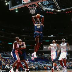 Antonio McDyess #24 of the Denver Nuggets dunks the ball against the Los Angeles Clippers on January 10, 2001 at Staples Center in Los Angeles, CA.