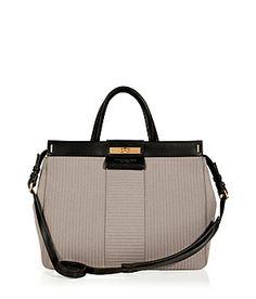 Lend a sporty look to your workweek style with Marc by Marc Jacobs' quilted neoprene convertible tote #Stylebop