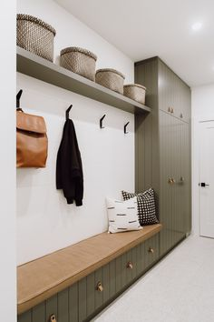 Before and After: A Canadian Home Gets a Polished Scandinavian Makeover ideas scandinavian Tour a Winnipeg Before and After inspired by Scandinavian Design Mudroom Laundry Room, Mudroom Cabinets, Bench Mudroom, Bathroom Cabinets, Built In Bench, Scandinavian Design, Scandinavian Interiors, Nordic Design, Interior Design