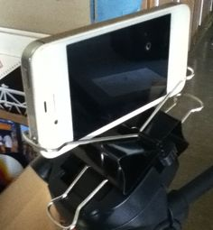 Use two large binder clips on a tripod to mount an iPhone (or probably any smart phone in landscape orientation)
