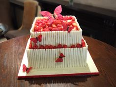 White Chocolate Cigarillos Red Fruit Red Butterflies Wedding Cake