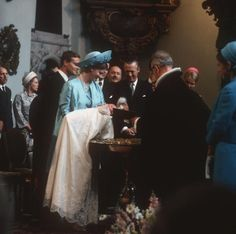 Princess Margrethe (now Queen) holding Prince Frederik at his christening