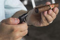 Tyler Omoth lights up a Punch Gran Puro Santa Rita cigar.