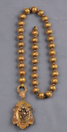 Etruscan Revival Gold Bead Necklace and Pendant, the necklace composed of thirty-five beads with applied bead and ropetwist accents, each measuring approx. 11.00 mm, and suspending a locket with central foliate motif