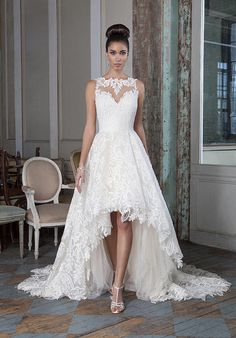 High-low ball gown featuring corded embroidered lace on a nude illusion neckline, with soft handkerchief underlay and an illusion back   Justin Alexander   https://www.theknot.com/fashion/9818-justin-alexander-signature-wedding-dress
