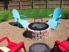DIY firepit I likethe small pebbles and add a brick back wall