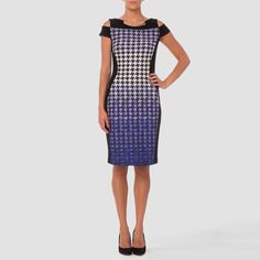 This joseph Ribkoff Original sheath dress has cutouts about the shoulders with cap sleeve design, bateau neckline with goldtone accent at the décolletage and a gorgeous houndstooth pattern that melts to a blue minutia look at the above-the-knee hem.
