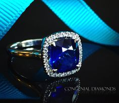 Love this antique inspired sapphire and diamond ring