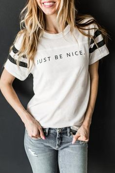 Spread love & kindness like it's your job! Features a ringer style sleeve and an adorable message. Doesn't matter what you pair it with, the message is simple & strong! *shirt is an antique white, not