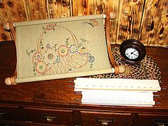 The Lap-stitch Doodler Frame is wonderful for those medium to larger projects.  It can turn in all directions to work on many types of needlework.  doodlinarounddesign.com $92.95