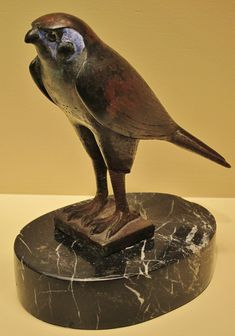 Bronze statuette of the God Horus in His form of sacred falcon; the eyes are made of dark glass circled with a golden ring. XXVI Dynasty (ca. 688–252 BCE). Now in the Chrysler Museum of Art in...