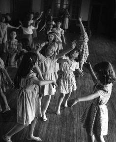Nina Leen, Young girls at Matthew F. Maury School improvising variations on their teacher's dance moves, Richmond, Virginia, USA, May 1950.