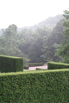 The hedged rooms were built on the property's rare bits of flat land.