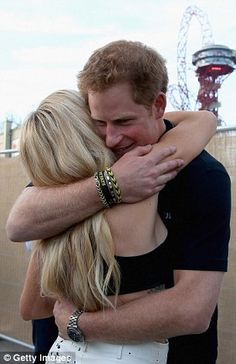 6/7/16. Prince Harry hugging Ellie Goulding