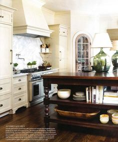my kitchen island...open shelves on 2 sides, seating in back, storage in front, on legs to look like a table