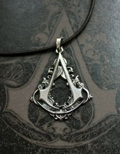 Assassin's Creed Necklace @Ellen Kramer how much would we love this running around town next to the guitar players!