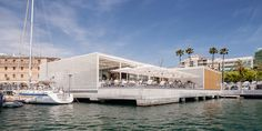 Filigree lattice screens in perforated metal make two marina buildings designed by SCOB Architecture and Landscape blend in harmoniously with the white yachts of their surroundings.