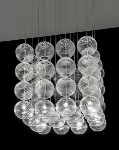 Vistosi Oto glass pendant lights grouped to form a Cube