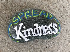 Spread Kindness. Hand painted rock by Caroline.
