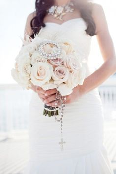 Very pretty wedding bouquet and I love the addition of the rosary for a catholic ceremony.