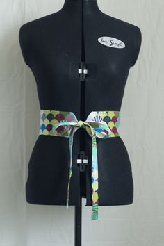 Obi-Style Belt Tutorial - I've seen this style belt paired with cute dresses and top/skirt sets. :) Neat!