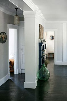captain's wheel mirror and large hand-blown green glass vase on floor. Daring and bold, but playful. Sea Cliff, Tin Tiles, Ceiling Tiles, Farmhouse Chic, Hallways, Magick, Bungalow, Tall Cabinet Storage, Console