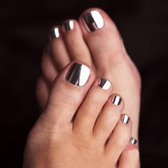 These toe nails ROCK. They're like little mirrors at the end of each toe. Makes me want to run out and get a pedicure!
