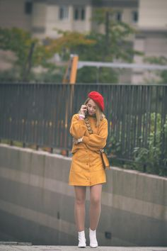 f9512c04bec67 Fall 2017 monochrome outfit white ankle boots guitar strap bag red beret  yellow button skirt Casual