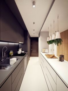 narrow kitchen designs: long narrow kitchen in white and black colors More