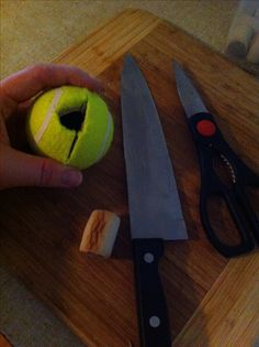 Homemade kong dog toy: cut a slit into a tennis ball, remove a small triangle. Fill the tennis ball with dog treats.