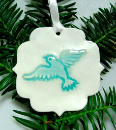 A beautiful handmade ceramic Christmas tree ornament, decorated with an elephant, a dove or a lotus flower.  The price is for one ornament - but all