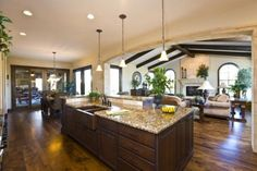 Hickory floors with nutmeg stain + love the island & beams in the living room, fireplace & windows