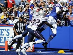 Buffalo Bills wide receiver Steve Johnson (13) catches a pass for a touchdown over New England Patriots free safety Devin McCourty (32) and Kyle Arrington during the second half of an NFL football game on Sunday, Aug. 8, 2013, in Orchard Park. (AP Photo/Gary Wiepert)