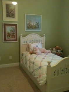"daughter's room ""granny smith apple green"" and hung childhood pictures"