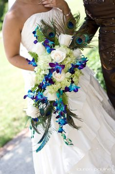 Blue dendrobium orchids, peacock feathers, white roses, green hydrangeas = gorgeous