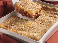 Sloppy Joe Squares - lb lean (at least 80%) ground beef 1 can (15.5 oz) sloppy joe sauce 2 cans (12 oz each) Pillsbury® refrigerated Big & Buttery crescent dinner rolls  2 cups shredded Cheddar cheese (8 oz),  1 tablespoon sesame seed